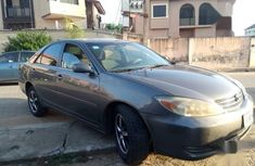 Need to sell grey 2004 Toyota Camry at mileage 125,000 in Ikeja
