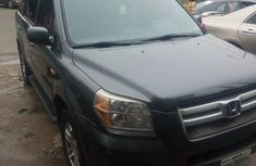 Best priced grey 2008 Honda Pilot automatic at mileage 197,000