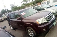Best priced red 2009 Honda Pilot suv automatic