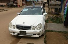 Need to sell white 2005 Mercedes-Benz E500 at mileage 180,000