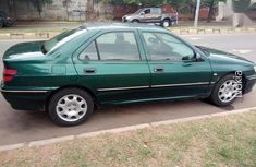 Best priced used green 2001 Peugeot 406 manual in Abuja