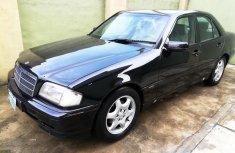 Black 2002 Mercedes-Benz C230 automatic at mileage 150,000 for sale