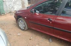 Sell used red 2004 Peugeot 206 hatchback manual at cheap price