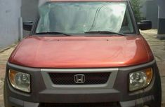 Best priced red 2005 Honda Element automatic in Lagos
