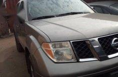Beige 2006 Nissan Pathfinder at mileage 132,541 for sale