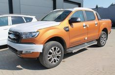 Neatly used orange 2019 Toyota Hilux automatic in Lagos