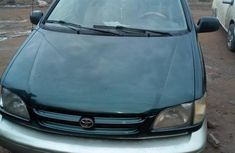 Green 2000 Toyota Sienna automatic at mileage 244,958 for sale