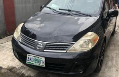 Need to sell black 2009 Nissan Versa at price ₦850,000