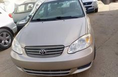 Best priced used gold 2002 Toyota Corolla automatic in Lagos