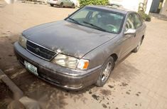 Grey/silver 1998 Toyota Avalon at mileage 132,230 for sale