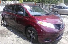Selling red 2015 Toyota Sienna automatic in good condition in Ikeja