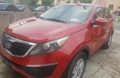 Need to sell high quality red 2011 Kia Sportage automatic at mileage 120,000