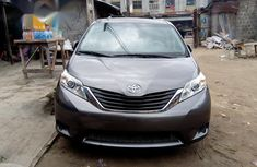 Grey/silver 2011 Toyota Sienna car at attractive price in Lagos