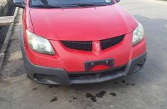 Selling red 2004 Pontiac Vibe automatic in Ikeja
