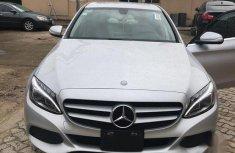 Best priced silver 2015 Mercedes-Benz C200 in Lagos