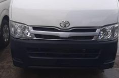Neatly used white 2014 Toyota Hilux automatic in Lagos