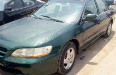 Best priced green 2002 Honda Accord sedan at mileage 150,000