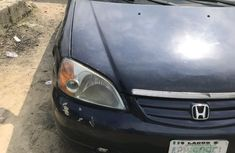 Need to sell cheap used blue 2002 Honda Civic sedan in Lagos