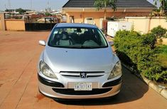 Sell well kept grey 2002 Peugeot 307 hatchback at price ₦700,000