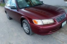 Need to sell high quality red 2001 Toyota Camry automatic at price ₦750,000