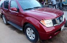 Red 2006 Nissan Pathfinder automatic at mileage 153,254 for sale in Ikeja