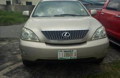 Well maintained gold 2010 Lexus RX at mileage 147 for sale