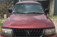 Red 2002 Mitsubishi Montero Sport car automatic at attractive price in Lagos