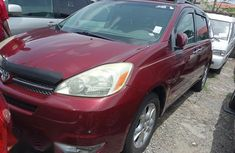 Selling red 2005 Toyota Sienna automatic in good condition in Lagos