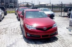 Selling red 2014 Toyota Camry automatic at price ₦5,500,000