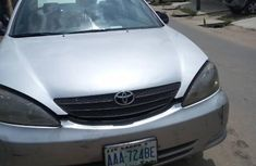 Need to sell grey 2003 Toyota Camry at mileage 150,000 in Ikeja