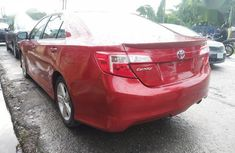Best priced red 2014 Toyota Camry sedan at mileage 41,000
