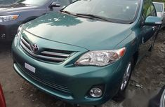 Best priced green 2010 Toyota Corolla at mileage 86,000