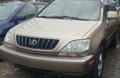 Used gold 2002 Lexus RX suv for sale at price ₦2,100,000