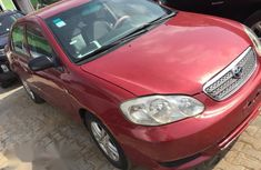 Need to sell cheap used red 2003 Toyota Corolla at mileage 89