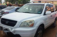 Need to sell white 2004 Honda Pilot at price ₦950,000 in Ikeja