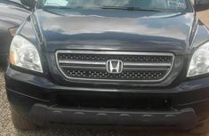 Black 2006 Honda Pilot automatic at mileage 102,358 for sale in Ikeja