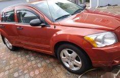 Selling orange 2007 Dodge Caliber hatchback in good condition