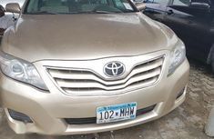 Need to sell cheap used gold 2011 Toyota Camry manual in Lagos
