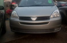 Best priced grey/silver 2004 Toyota Sienna in Lagos