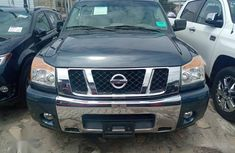 Sharp used green 2014 Nissan Titan pickup  car at attractive price