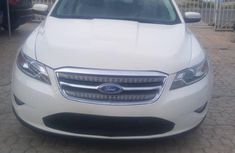 Used white 2011 Ford Taurus automatic car at attractive price