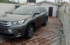 Need to sell grey 2019 Toyota Highlander at mileage 50,002
