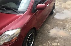 Red 2007 Toyota Yaris car automatic at attractive price in Ikeja