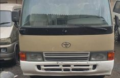 Best priced used gold 2007 Toyota Coaster manual in Lagos