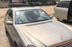 Used gold 2004 BMW 320 sedan at mileage 130,000 for sale