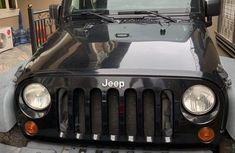 Selling 2011 Jeep Wrangler in good condition at mileage 54,000