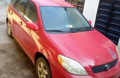 Sell used red 2002 Toyota Matrix hatchback manual
