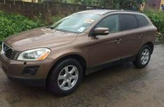 Clean used gold 2011 Volvo XC60 suv  automatic for sale in Lagos