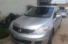 Best priced grey 2010 Nissan Versa suv automatic in Lagos