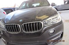 Best priced black 2015 BMW X5 at mileage 45,000 in Lagos